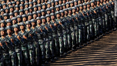 Chinese troops march in formation on Sunday.