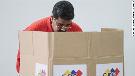 "Handout photo released by the Venezuelan Presidency shows president Nicolas Maduro casting his vote in Caracas on July 30, 2017. Polls opened in Venezuela on Sunday for the election of a new, all-powerful ""Constituent Assembly"" that President Nicolas Maduro promised would end his country's political and economic crisis by rewriting the constitution. The vote has been fiercely opposed by months of deadly street protests and criticized internationally. Venezuela's opposition says it is a bid for the beleaguered Maduro to cling to power by getting around the parliament controlled by its lawmakers."