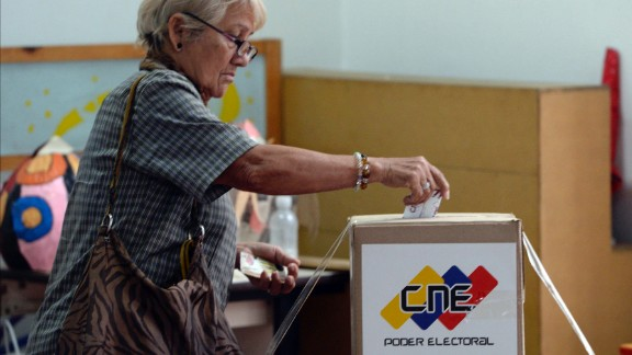 A woman casts her vote to elect a Constituent Assembly in Caracas on Sunday.