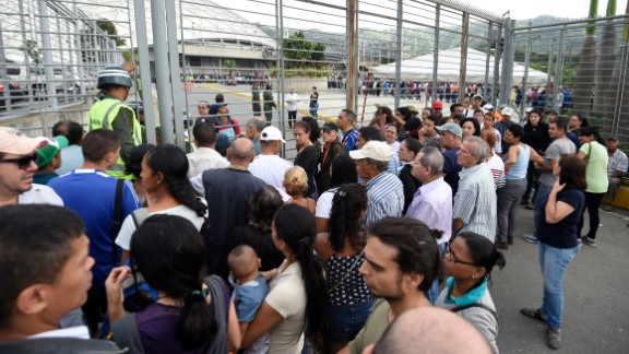 People queue to cast their vote to elect a Constituent Assembly in Caracas on Sunday.