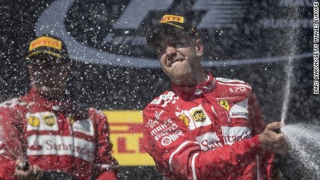 Sebastian Vettel celebrates on the podium after a Ferrari one-two in Hungary.