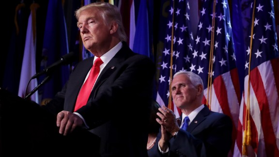 Republican president-elect Donald Trump delivers his acceptance speech as Vice president-elect Mike Pence looks on during his election night event at the New York Hilton Midtown in the early morning hours of November 9, 2016 in New York City. Donald Trump defeated Democratic presidential nominee Hillary Clinton to become the 45th president of the United States.