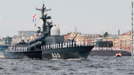A Russian Navy vessel sails along the Neva River during the naval parade for Russia's Navy Day in St. Petersburg.