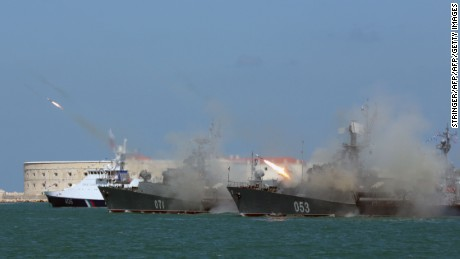 Russian navy frigates fire missiles during Russia's Navy Day celebration in Sevastopol in Crimea.