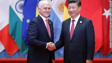 Chinese President Xi Jinping shakes hands with Australia's Prime Minister Malcolm Turnbull on September 4, 2016 in Hangzhou, China