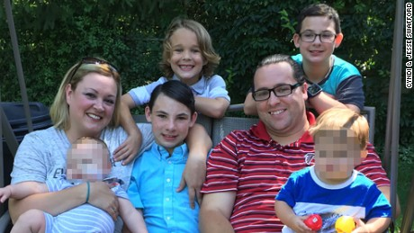 In the last decade, the Swafford family has taken in 15 foster children. Of the 15 foster children Cyndi and Jesse have taken in over the last decade, 13 are there because of their birth parent's drug addiction. From left to right: Cyndi & Jesse Swafford with foster babies, adopted son Kalib Swafford, biological son Cole Swafford, adopted son Brandon Swafford. CNN obscured a portion of this image to protect the identities of the two foster children.