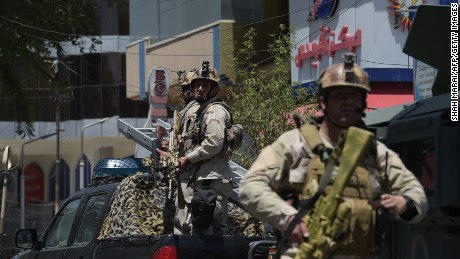 Afghan security personnel arrive at the site of a suicide blast in Kabul on July 31.