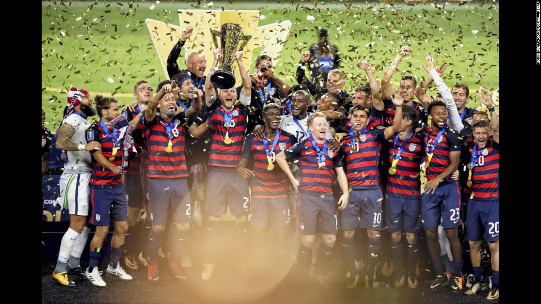US soccer captain Michael Bradley lifts the Gold Cup as he and his teammates celebrate their tournament victory in Santa Clara, California, on Wednesday, July 26. The Americans defeated Jamaica 2-1 in the final.