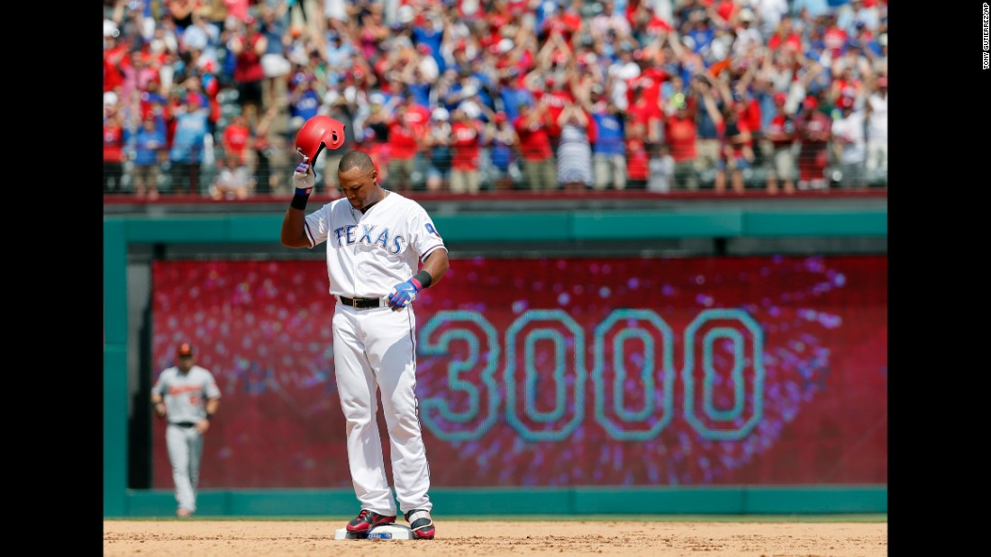 Texas' Adrian Beltre tips his helmet to the cheering home crowd after collecting his 3,000th career hit on Sunday, July 30. He is the 31st player in history to reach the milestone.
