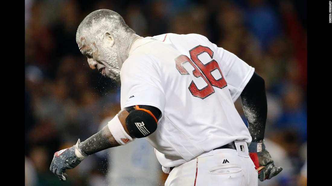 Boston second baseman Eduardo Nunez is covered in baby powder after driving in the game-winning run against Kansas City on Saturday, July 29. His teammates threw the powder on him during the celebration.