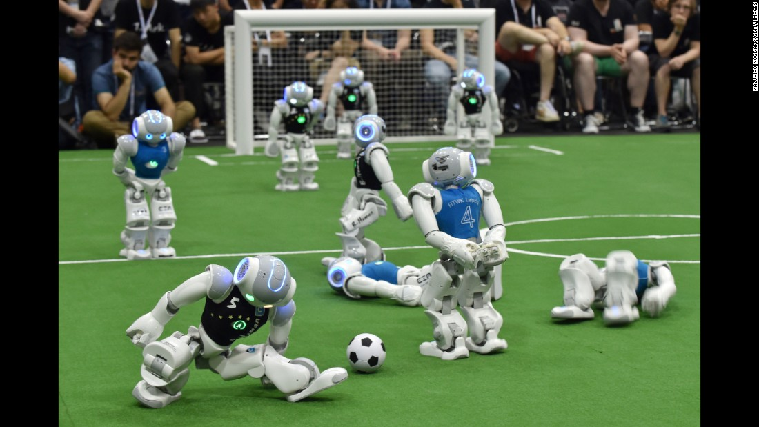 Robots play soccer during the RoboCup tournament in Nagoya, Japan, on Sunday, July 30. The annual event attracts robotics teams from all over the world.