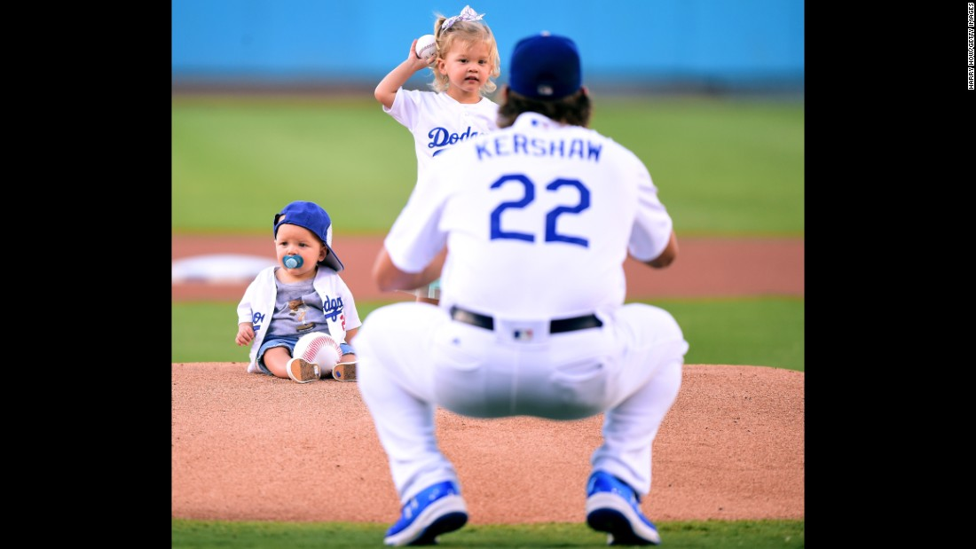 Cali Ann Kershaw throws out the first pitch to her father, Los Angeles Dodgers ace Clayton Kershaw, before a home game on Wednesday, July 26. Sitting on the mound is Cali Ann's brother, Charley Kershaw.