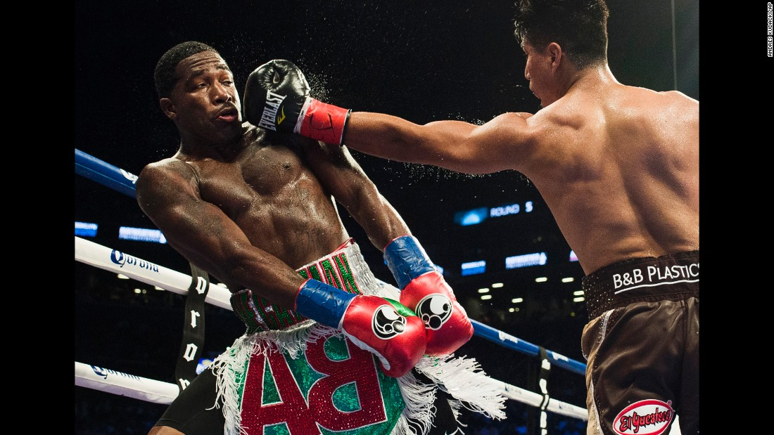 Mikey Garcia punches Adrien Broner during their junior-welterweight bout in New York on Saturday, July 29. Garcia won by unanimous decision and remains undefeated in his professional career (37-0).