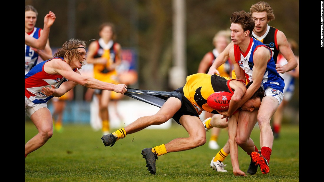 Dandenong's William Hamill is tackled by players of the Gippsland Power during an Australian rules football match in Melbourne on Saturday, July 29.