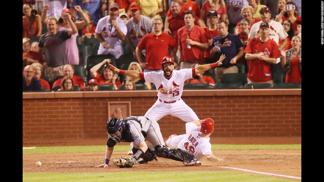 Matt Carpenter calls St. Louis teammate Harrison Bader safe as Bader scores the game-winning run against Colorado on Tuesday, July 25. Bader scored on a sacrifice fly by Jedd Gyorko.