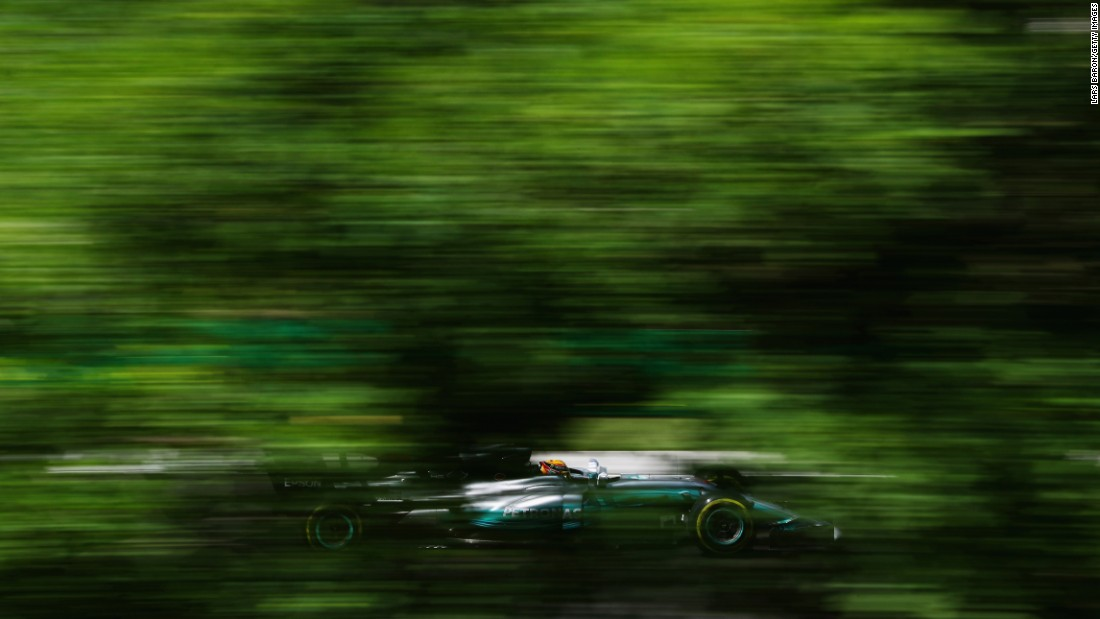 Formula One driver Lewis Hamilton whizzes by Friday, July 28, during a practice run at the Hungarian Grand Prix.