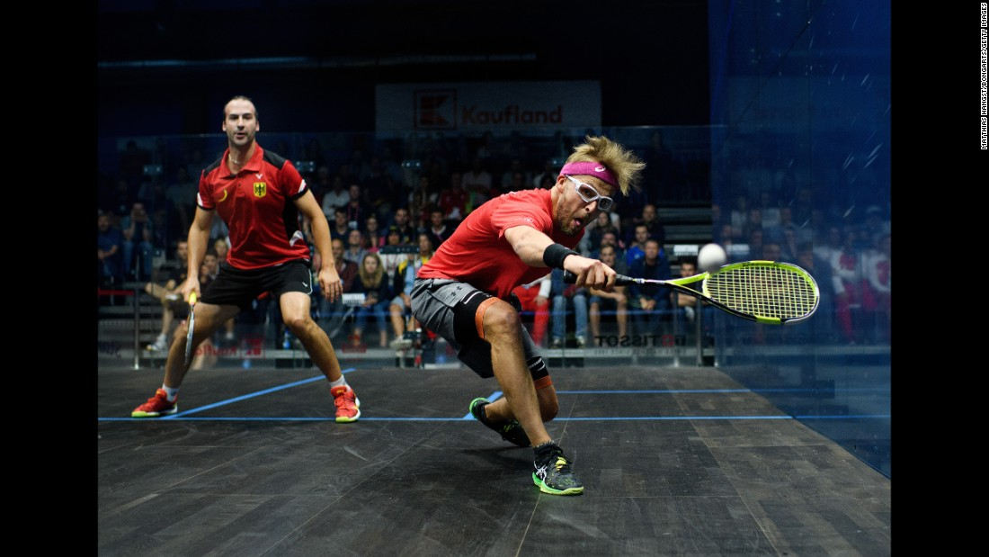 Polish squash player Wojciech Nowisz plays a shot against Germany's Simon Rosner during a World Games match on Tuesday, July 25. Rosner would go on to win gold.