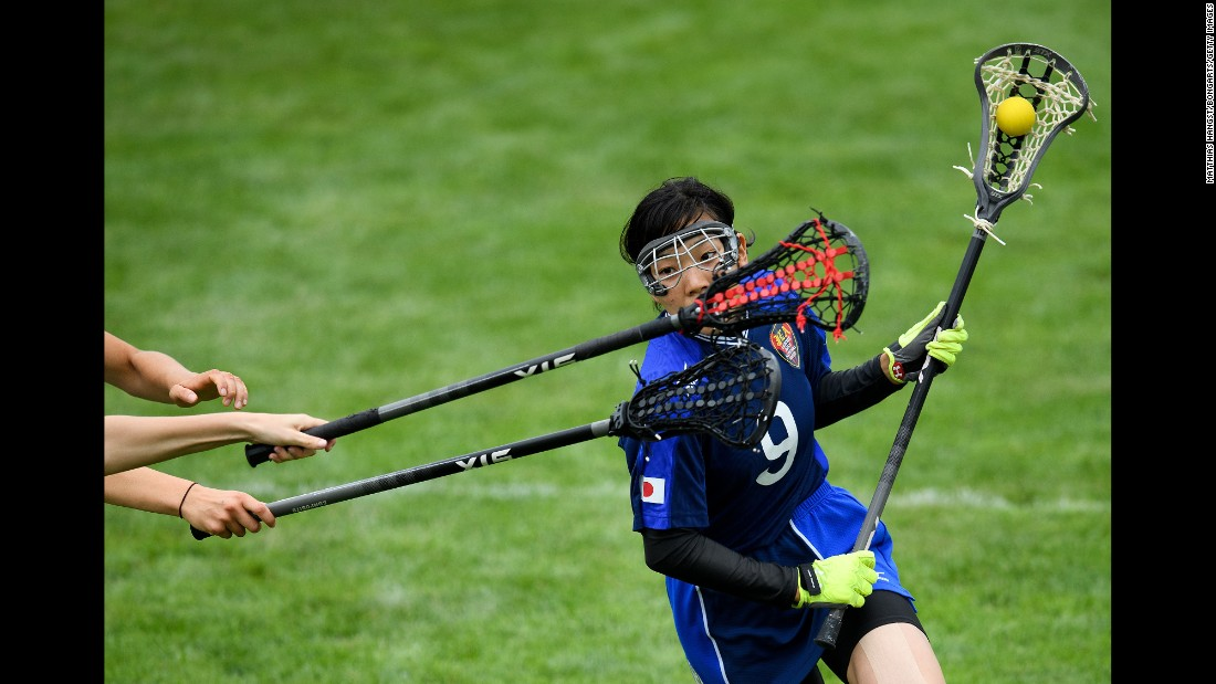 Japanese lacrosse player Sachiko Komine avoids two British players at the World Games on Thursday, July 27.
