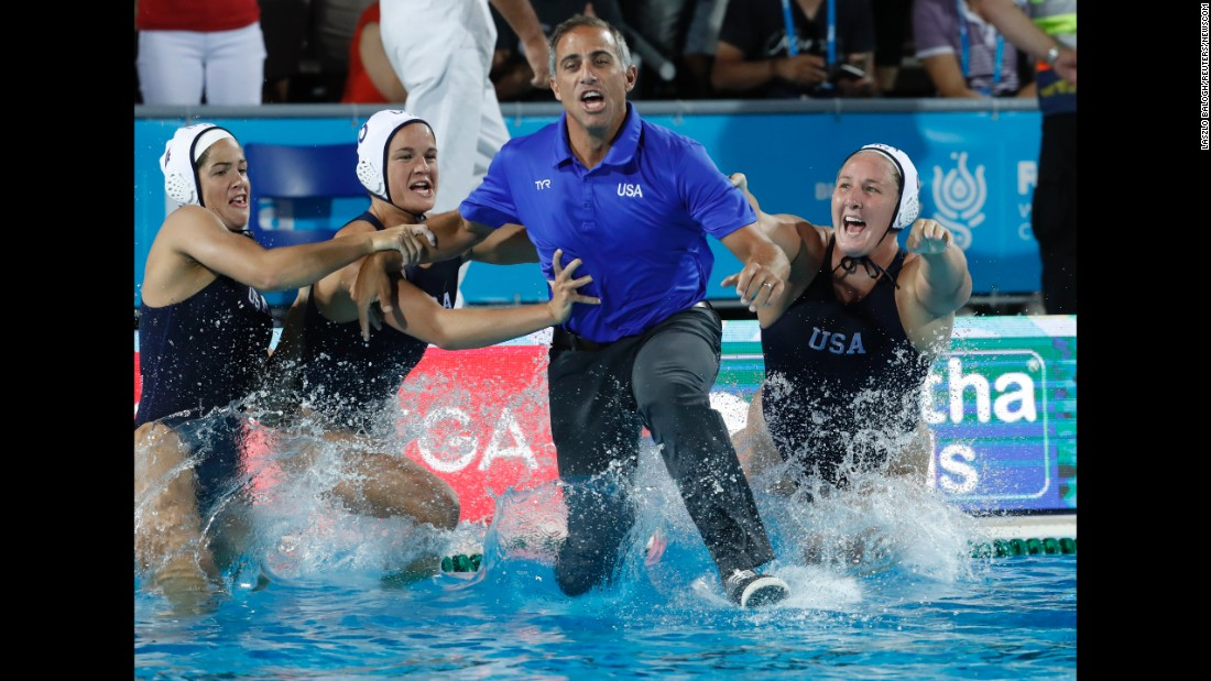US water polo coach Adam Krikorian jumps into the pool after the Americans defeated Spain in the final of the FINA World Championships on Friday, July 28.
