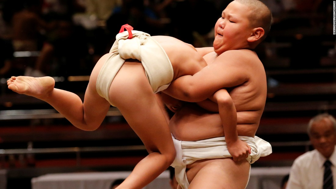 Elementary school sumo wrestlers compete at the Wanpaku tournament in Tokyo on Sunday, July 30.