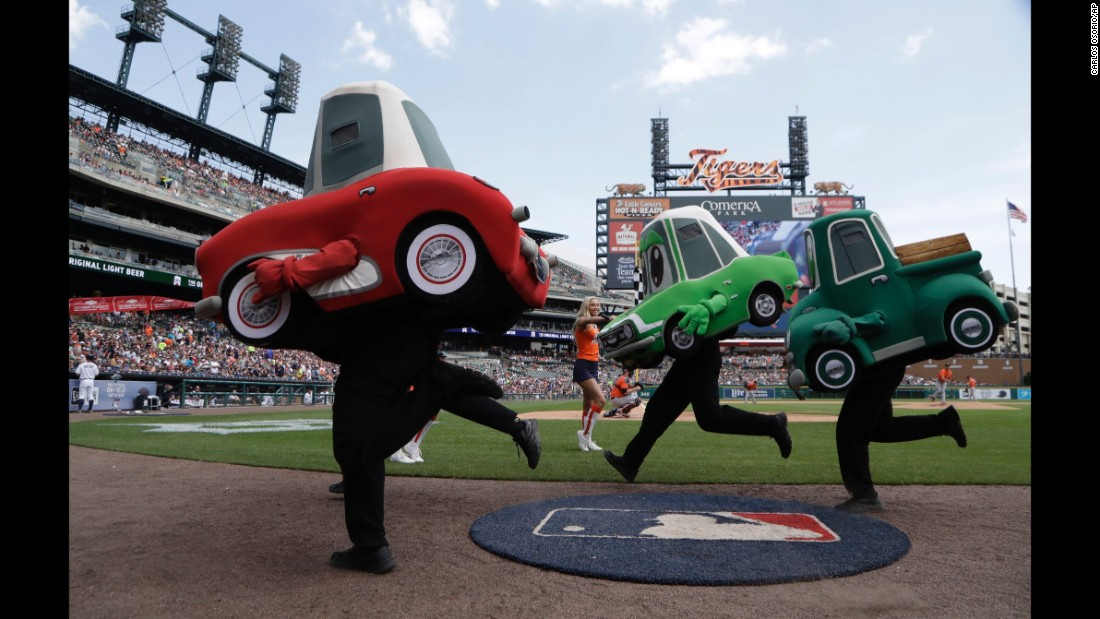 The Motor City Wheels race during the fourth inning of a Major League Baseball game in Detroit on Sunday, July 30.