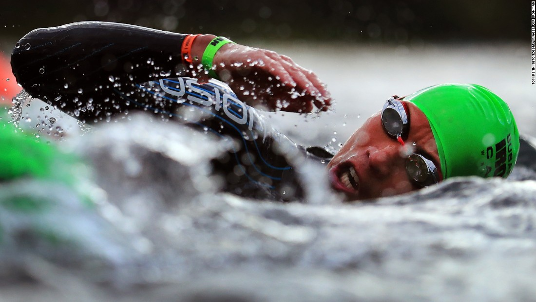 A triathlete swims during the Ironman Canada event on Sunday, July 30.