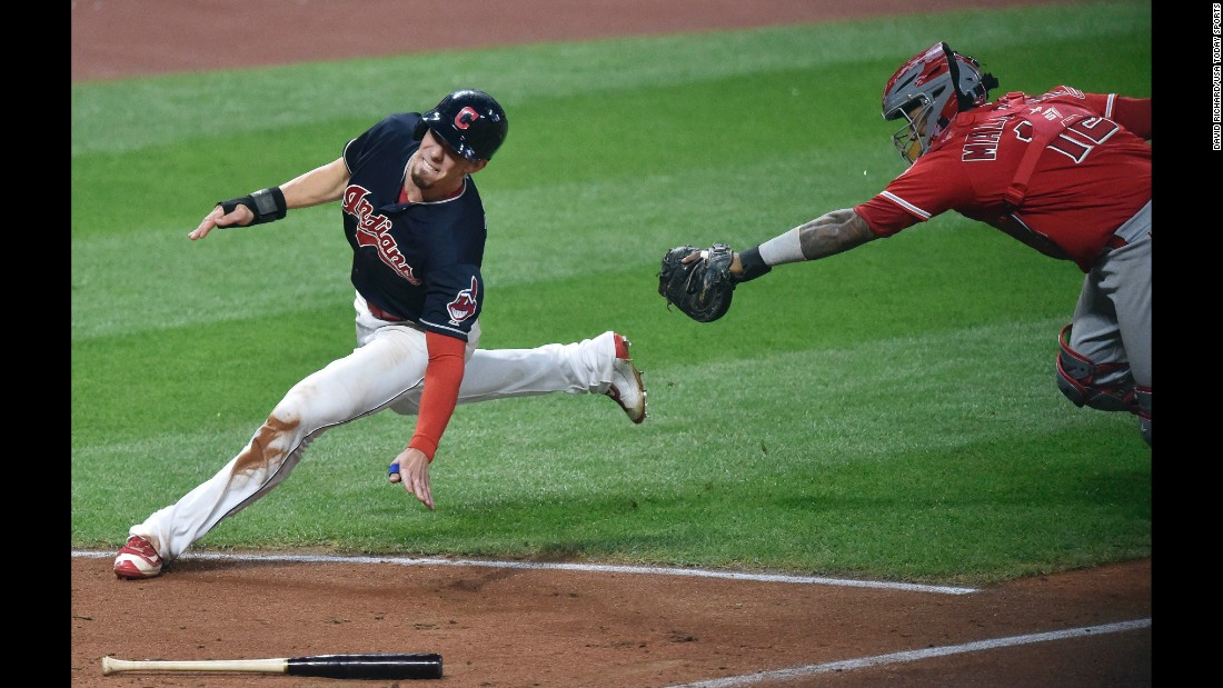 Cleveland's Bradley Zimmer avoids a tag from Los Angeles Angels catcher Martin Maldonado on Wednesday, July 26.