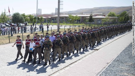 Defendants are escorted under heavy security to court in the capital, Ankara, on Tuesday.