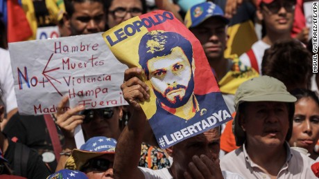 epa06078439 Opposition supporters, some holding posters of Leopoldo Lopez, rally to mark the 100th day of protests in Caracas, Venezuela, 09 July 2017. Encouraged by the recent release of political prisoner and oppositon leader,  Leopoldo Lopez, to house arrest, thousands of supporters marked 100 days of protests against  President Nicolas Maduro?s government who they claim is responsible for economic disaster and political repression.  EPA/Miguel Gutierrez