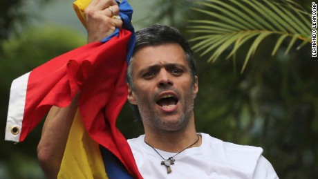 Leopoldo Lopez greets supporters outside his Caracas home July 8 after his release to house arrest.
