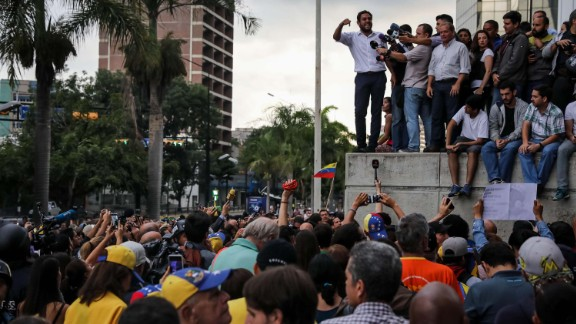 Opposition lawmaker Juan Requesens addresses a rally in Caracas on July 31. Two other leading opposition figures, Leopoldo Lopez and Antonio Ledezma, were rounded up from their homes, according to their families.