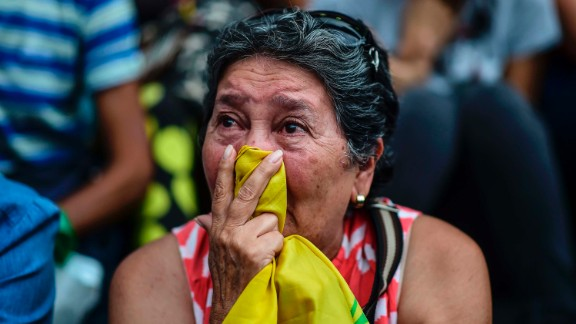 A woman in Caracas attends a vigil Monday, July 31, for anti-government activists who have died in the country's recent unrest. More than 120 people have been killed in Venezuela since early April, according to the attorney general's office.