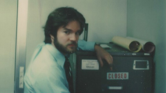 Booth was assigned to Geneva, Switzerland, in 1977 as a US State Department security officer at the SALT nuclear weapons arms reduction negotiations with the Soviet Union. Shown here in a tongue-in-cheek photo, Booth posed next to a high-security file cabinet containing top secret code word information about US nuclear weapons capabilities.