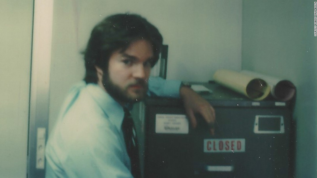 Booth was assigned to Geneva, Switzerland, in 1977 as a US State Department security officer at the SALT nuclear weapons arms reduction negotiations with the Soviet Union. Shown here in a tongue-in-cheek photo, Booth posed next to a high-security file cabinet containing Top Secret codeword information about US nuclear weapons capabilities.