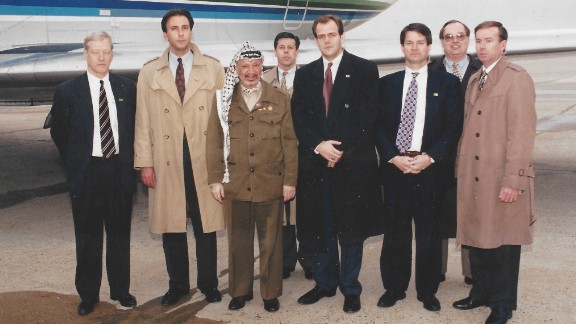 In the late 1990s, Booth, third from the right, was assigned to protect Palestinian leader Yasser Arafat, shown here shortly before his departure outside Washington, D.C. at what was then Andrews Air Force Base in Maryland.