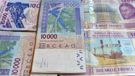 This photo taken on April 9, 2016 in a N'djamena, Chad, shows CFA banknotes of the CFA currency issued by the  Central Bank of West African States (Banque Centrale des Etats de l'Afrique de l'Ouest, BCEAO) and used in the eight west African countries which share the common West African CFA franc currency.  Finance ministers from African countries that use the franc and their French counterpart Michel Sapin meet in Yaounde, Cameroon, on April 9, 2016 to discuss the future of the CFA currency. / AFP / ISSOUF SANOGO        (Photo credit should read ISSOUF SANOGO/AFP/Getty Images)
