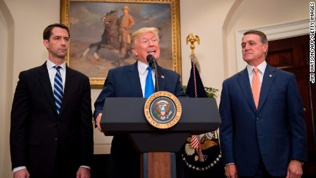 US President Donald Trump (C) makes an announcement on immigration with US Senator Tom Cotton (L), R-Arkansas and US Senator David Perdue (R), R-Georgia, at the White House in Washington, DC, on August 2, 2017.   / AFP PHOTO / JIM WATSON        (Photo credit should read JIM WATSON/AFP/Getty Images)