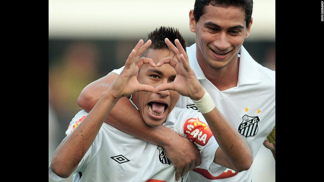 Neymar makes a heart gesture after scoring a goal for Santos in August 2010. That season, he scored 42 goals in all club competitions.