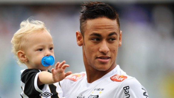 Neymar holds his son, Davi Lucca, at a Santos match in May 2013.