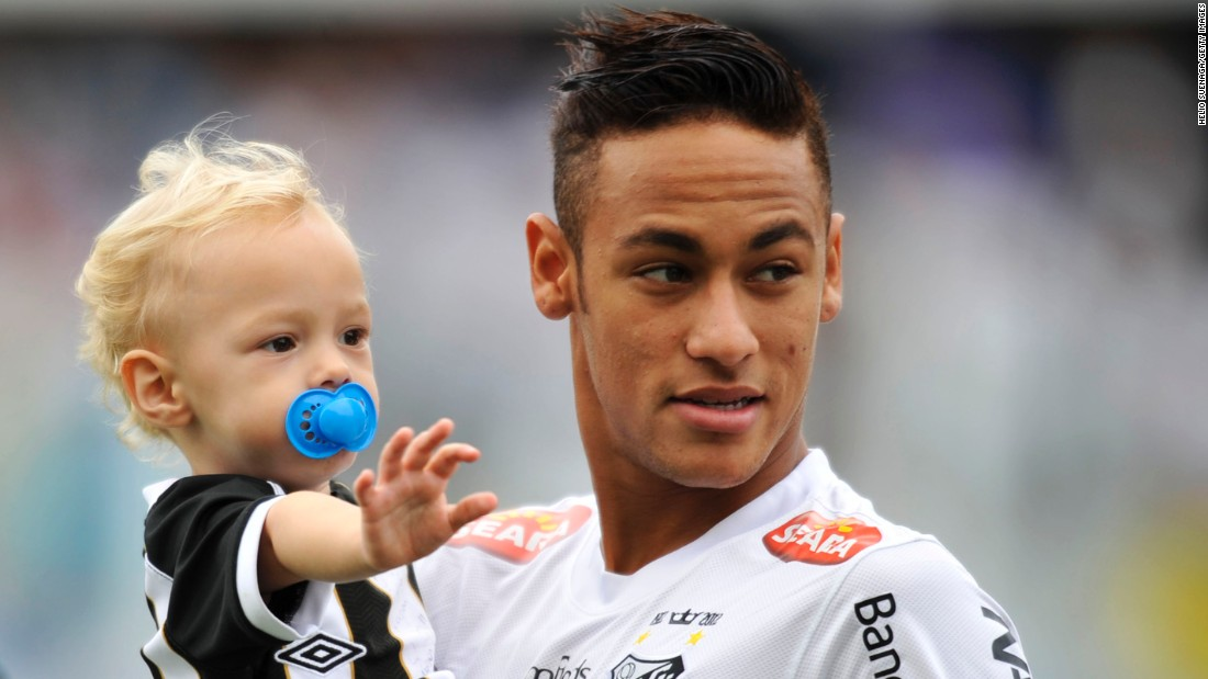 Neymar leaving barcelona one of the toughest decisions of my neymar holds his son davi lucca at a santos match in may 2013 stopboris Gallery