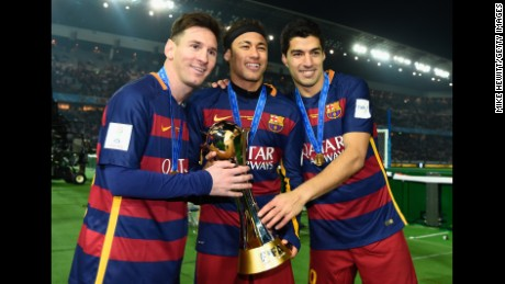 YOKOHAMA, JAPAN - DECEMBER 20:  Lionel Messi, Neymar and Luis Suarez of Barcelona hold the Winner's Trophy after the FIFA Club World Cup Japan 2015 Final between River Plate and FC Barcelona at International Stadium Yokohama on December 20, 2015 in Yokohama, Japan.  (Photo by Mike Hewitt - FIFA/FIFA via Getty Images)