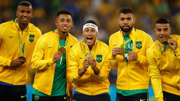 Neymar and his Brazilian teammates show off their Olympic gold medals.
