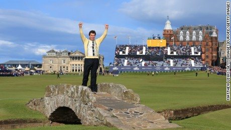 ST ANDREWS, SCOTLAND - JULY 17:  Sir Nick Faldo of England waves to the crowd as he stands on Swilcan Bridge during the second round of the 144th Open Championship at The Old Course on July 17, 2015 in St Andrews, Scotland. This is Faldo's last Open at the course.  (Photo by Matthew Lewis/Getty Images)