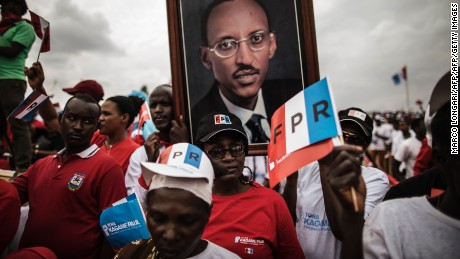 Supporters of President Paul Kagame carry a photograph of him at a rally in Kigali, on August 2, 2017.