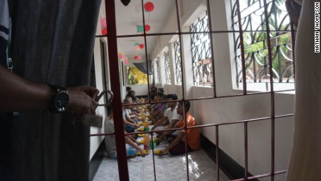 Clients at an addiction treatment centre in Bangladesh eat lunch together. They form a therapeutic community and help each other to stay clean. It's not a prison, but the doors are locked in case the craving for drugs becomes so unbearable that they try to escape.
