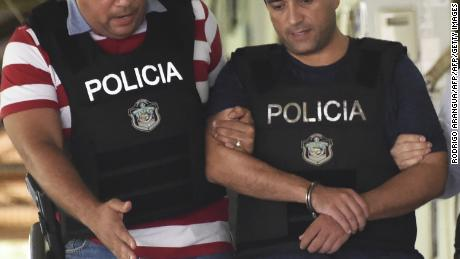 Roberto Borge (R), the former governor of the state of Quintana Roo, the sixth Mexican ex-governor under arrest for corruption, fraud, money laundering or involvement in organized crime, is escorted by Panamanian police in Panama City on June 5, 2017. Mexico sought Monday to extradite Borge, wanted on corruption charges, after he was arrested in Panama trying to board a flight to Paris. / AFP PHOTO / RODRIGO ARANGUA        (Photo credit should read RODRIGO ARANGUA/AFP/Getty Images)