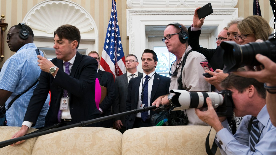 "White House Communications Director Anthony Scaramucci is surrounded by reporters in the Oval Office while US President Donald Trump meets with John Kelly, his new White House chief of staff, on Monday, July 31. After Kelly's swearing-in ceremony, Scaramucci learned that he was being asked <a href=""http://www.cnn.com/2017/07/31/politics/anthony-scaramucci/index.html"" target=""_blank"">to step aside </a>after just 10 days on the job."