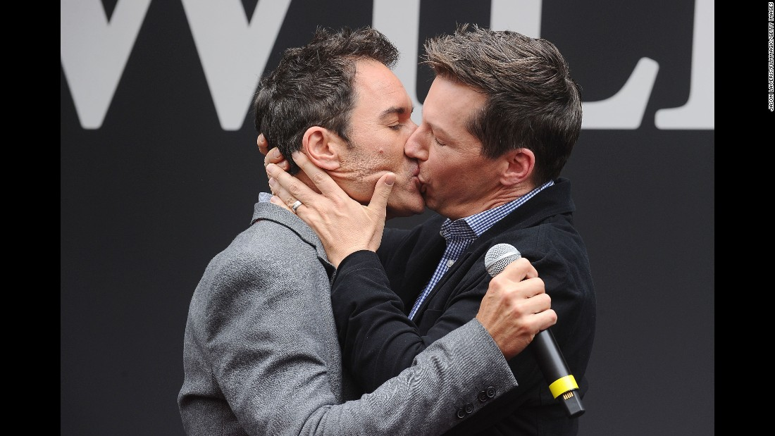 """Will & Grace"" co-stars Eric McCormack, left, and Sean Hayes kiss during a kickoff event in Universal City, California, on Wednesday, August 2. <a href=""http://www.cnn.com/2017/01/18/entertainment/will-and-grace-revival-return-nbc/index.html"" target=""_blank"">The television show is resuming</a> after an eight-year run that ended in 2006."