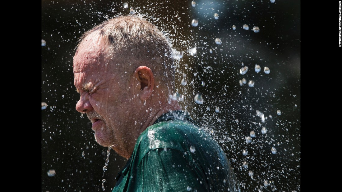"A man cools off in a fountain in Eugene, Oregon, as temperatures climbed into triple digits on Wednesday, August 2. <a href=""http://www.cnn.com/2017/08/03/us/pacific-northwest-heat-seattle-portland/index.html"" target=""_blank"">In the Pacific Northwest,</a> some 15 million people are under excessive heat warnings and advisories."