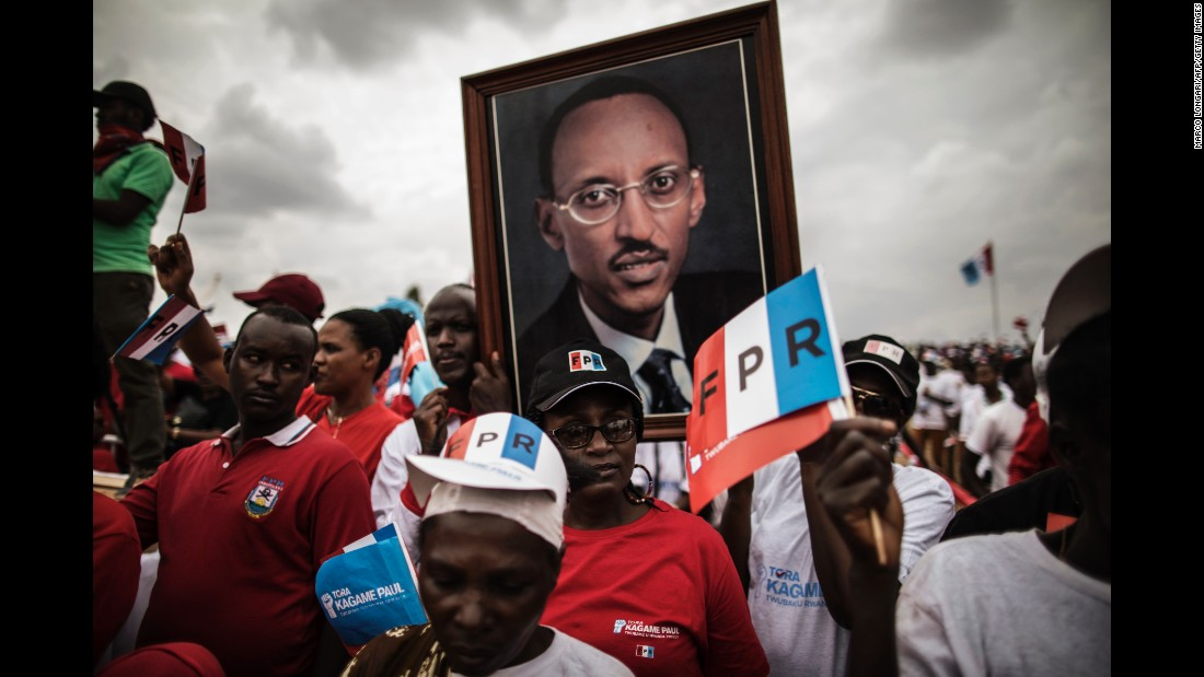 Supporters of Rwandan President Paul Kagame carry a large photograph of him during a campaign rally in Kigali, Rwanda, on Wednesday, August 2.